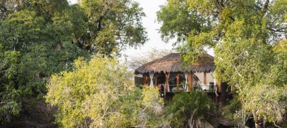 Mukambi Safari Lodge set over the river