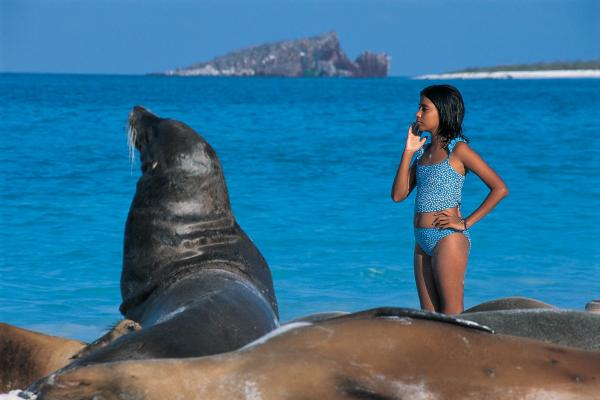Sea lion and a young traveler soaking up the sun in the Galapagos