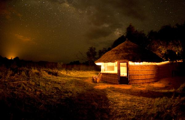 Hut exterior at night