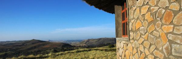 Exterior of one of the huts at Simien Lodge