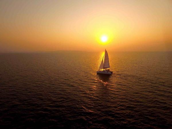 SY Meltemi sailing the Andaman Islands at sunset