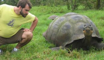 Hanging with a giant Galapagos tortoise