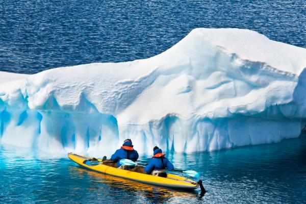 Kayaking toward an iceberg