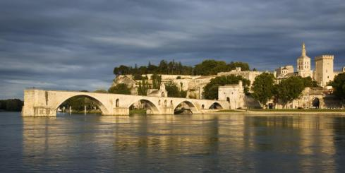 Medieval Saint-Bénezet bridge/Pont d'Avignon and Rhone River in Avignon, France