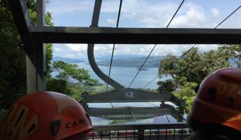 Tram ride up to the zip line with Lake Arenal in the distance