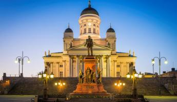 Helsinki Cathedral illuminated at dusk overlooking Senate Square