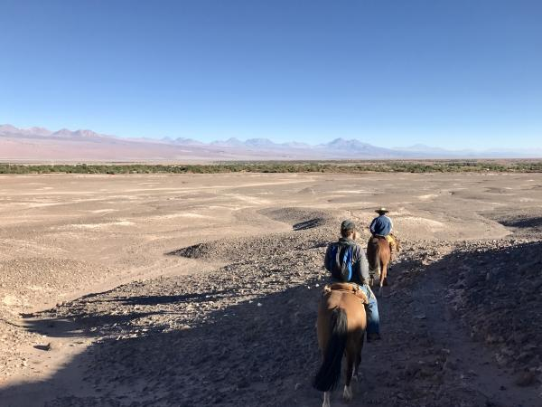 riding back down to San Pedro de Atacama valley