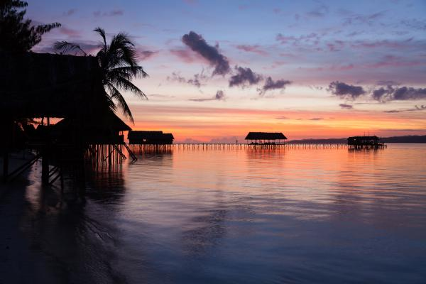 Sunset at an ocean resort in Raja Ampat, West Papua, Indonesia