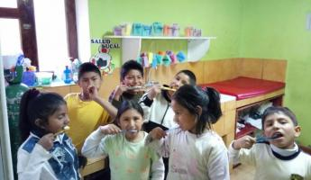 Children at Mantay brushing their teeth