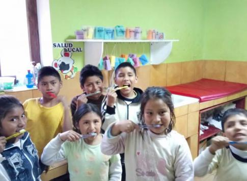 Mantay kids brushing their teeth