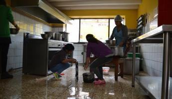 Mantay women washing the kitchen from top to bottom