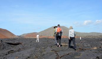 Our group enjoys the lava flows at Sullivan Bay.
