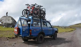 People preparing to mountain bike in Cotopaxi National Park.