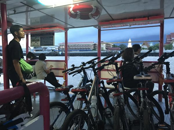 Taking the ferry across the river on our bike tour
