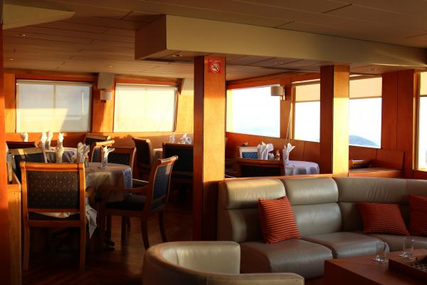 Enjoy lunch in the spacious dining room aboard the Millennium