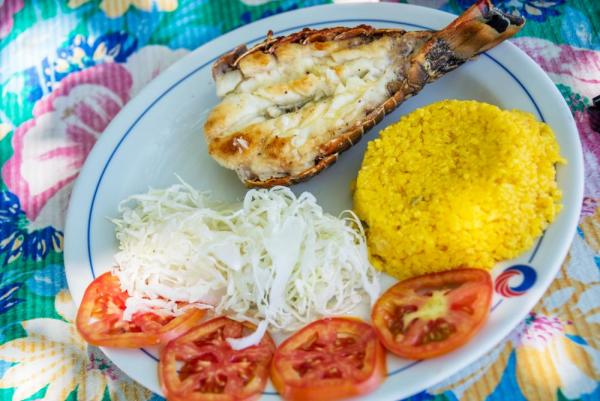 Grilled lobster with rice and salad in Cuba