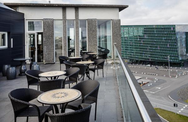 Outdoor patio seating with views of Harpa
