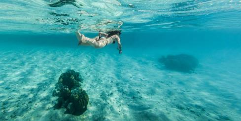 Woman snorkeling in clear water in Bora Bora
