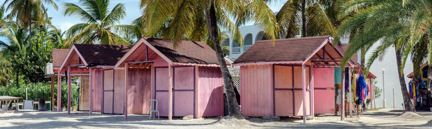 Pink beach huts in the Caribbean