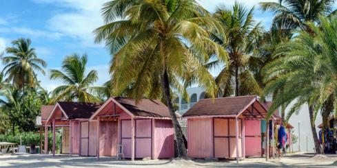 Pink beach huts on tropical Antigua island
