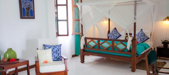 Bedroom at Flame Tree Cottages