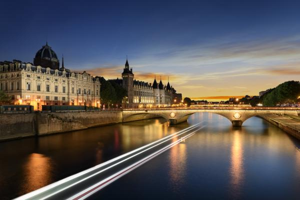 Touring on Seine river in Paris with sunset