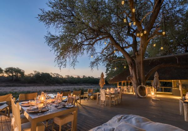 Meals are served on Simbavati's starlit patio