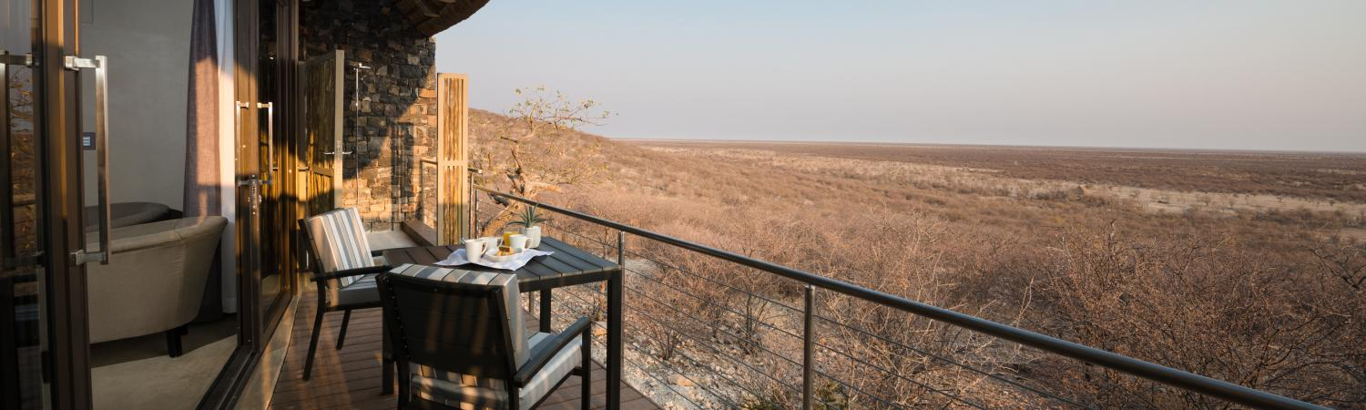 Spend your mornings with a coffee in hand overlooking Etosha National Park