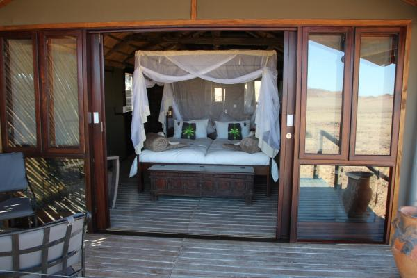 Your spacious room opens up onto the plains of the Namid desert