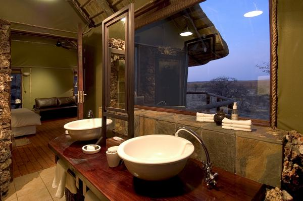 Freshn up in your modern and clean bathroom at Ongava Lodge