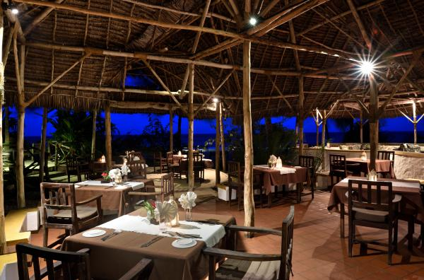 Gather in the dining area for a delicious meal of local Zanzibar cuisine