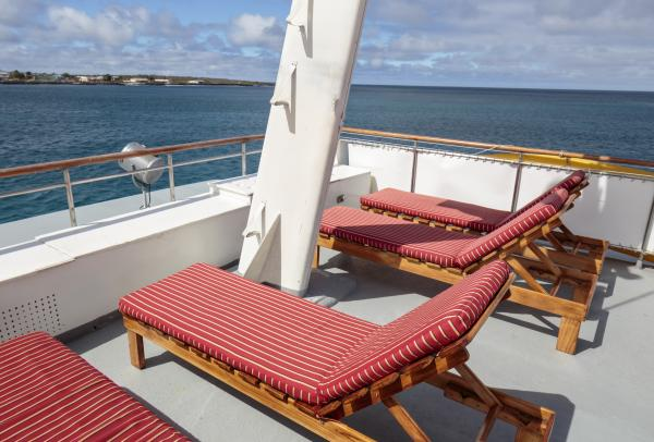 Soak in the warm Galapagos sun from the sun deck