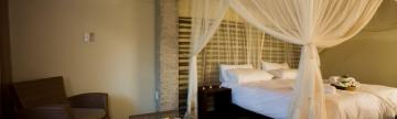 Settle into your comfortable bedroom at Okaukuejo Resort