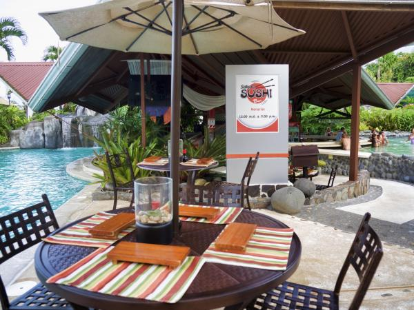 Relax at the poolside, Arenal Springs Hotel