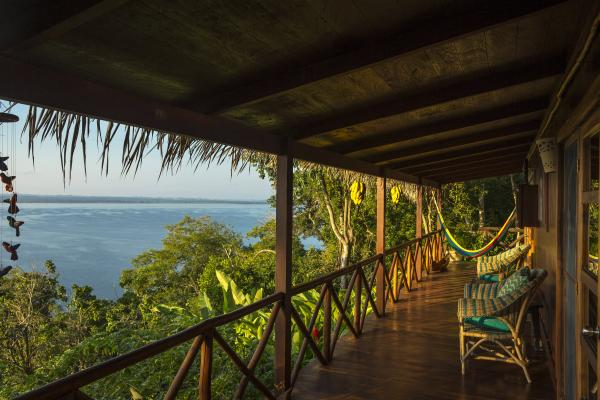 Relax on the deck of the Rainforest Casita