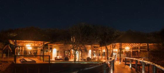 Moditlo Lodge's walkways lit up at night