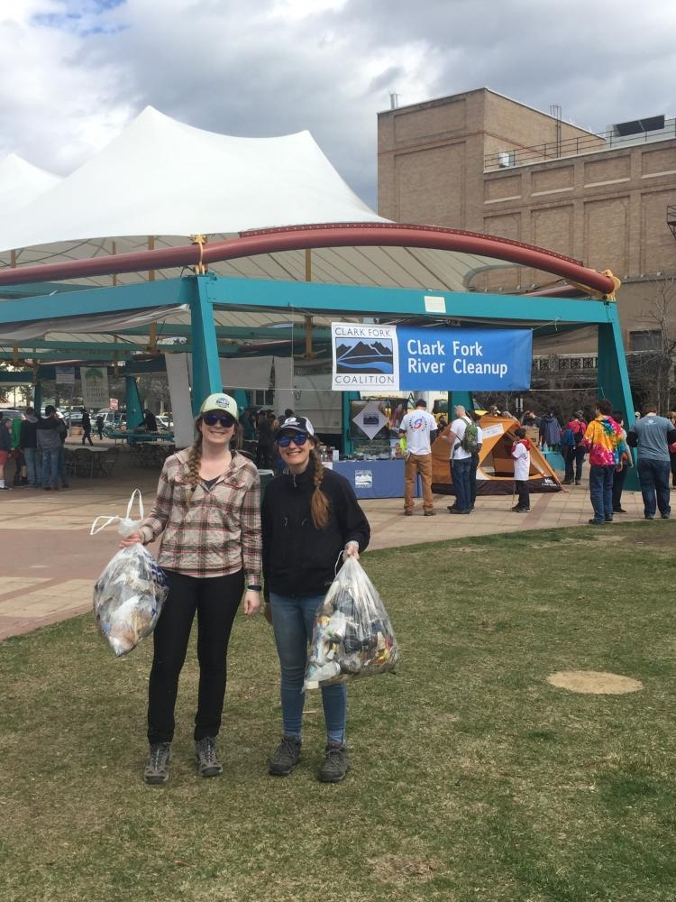 Adlifers Meg and Molly with full bags of collected trash in Caras Park after the cleanup