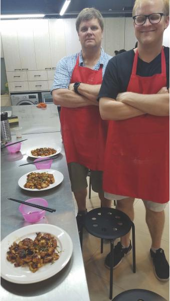The proud makers of Kung Pao chicken in a cooking class in Shanghai