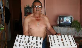 A local man displays arrowheads for sale