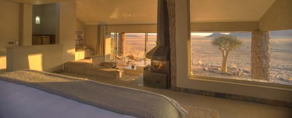 The desert's lighting at sundown warms the private villas