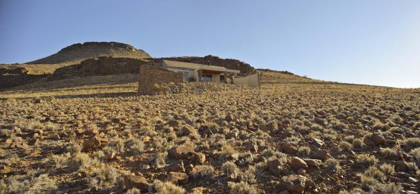 A chalet blends in with the surrounding desert