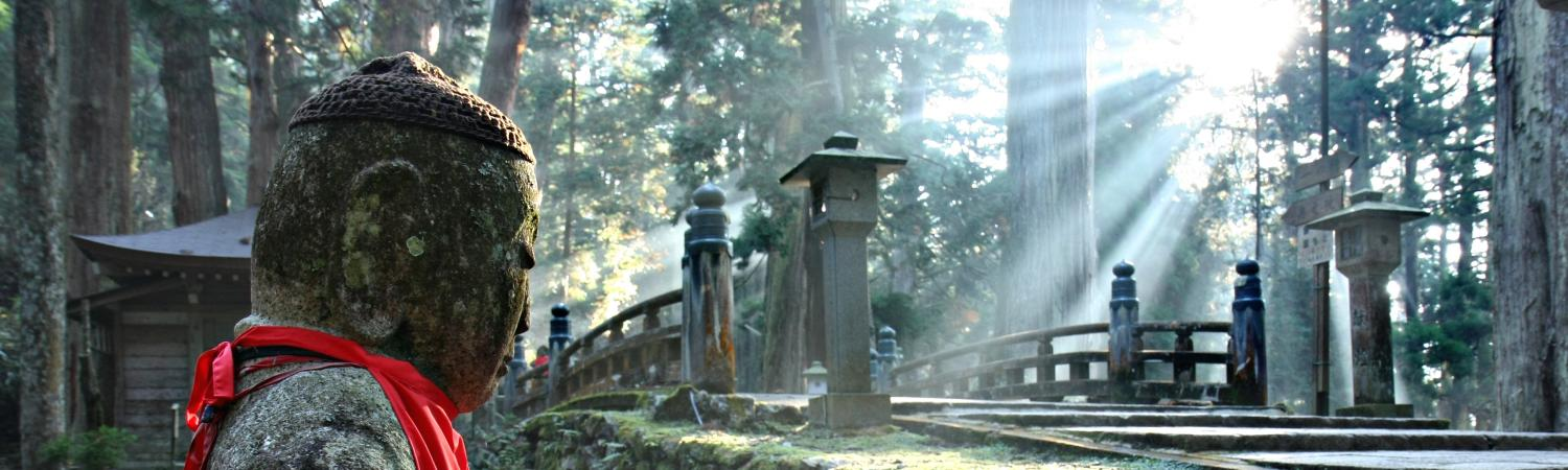 Sunlit shrine in an Osaka cemetery