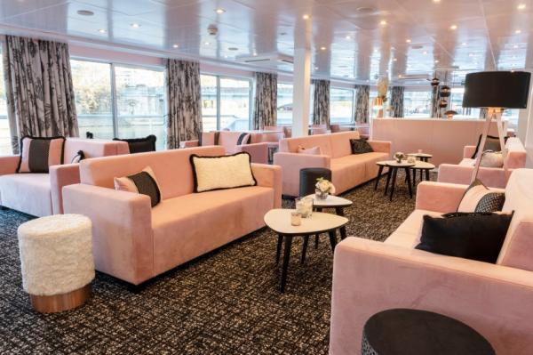 Relax in the lounge on the MS Renoir