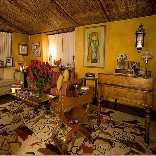 A drawing Room at Hacienda San Augustin de Callo with Ecuadoran Art on display