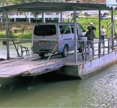 Taking the ferry across the river from Xunantunich