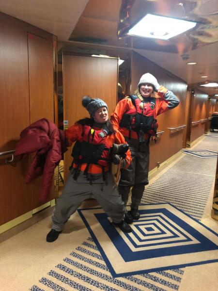 Karen and Meg prepped for kayaking in their dry suits and life jackets