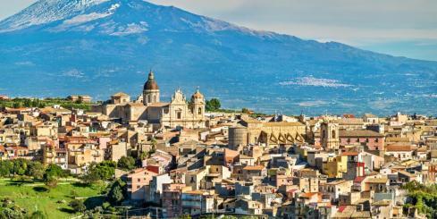 Mount Etna looms over an Italian town