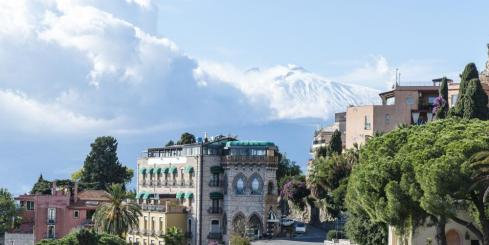 Beautiful Taormina, Italy, with Mt. Etna in the background