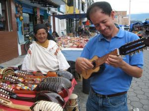 Playing a charango at the local market in Otavalo, Ecuador