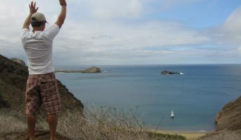 Waving to the ship while hiking on San Cristobal, Galapagos Islands